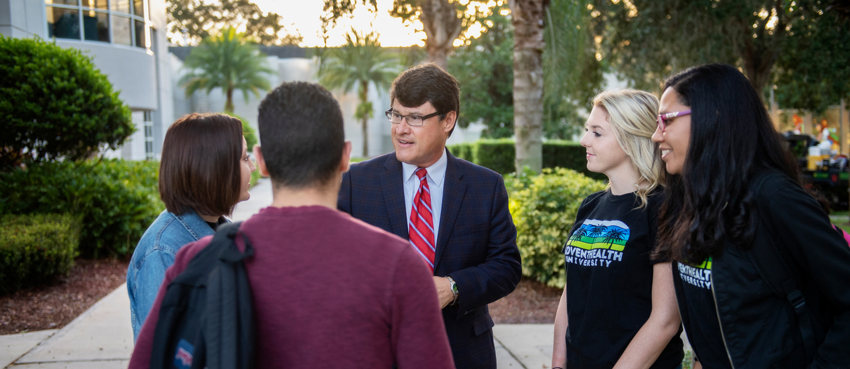 President Edwin Hernandez talking with students