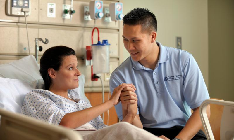Clinical team member praying with patient
